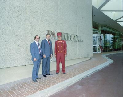 Parkroyal Hotel, the General Manager Peter Christian, John Brown Minister for Sport, Recreation and Tourism and bellboy are standing near the main entrance