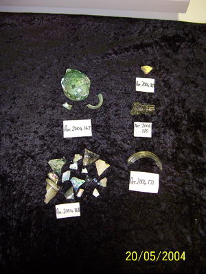 Three (3) clear glass bottle fragments