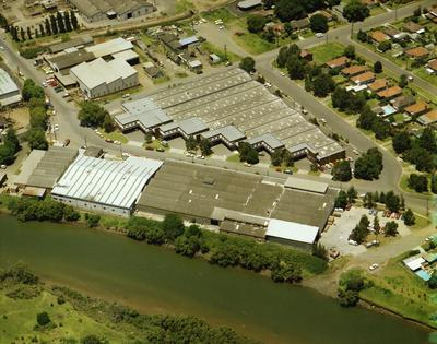 Aerial view of Parramatta River and warehouses at River Road West and Arthur Street.