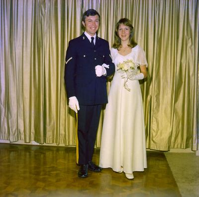 Parramatta Mayoral Ball 1976 : Portrait of a debutant and a man standing