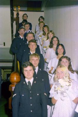 Parramatta Mayoral Ball 1976 : debutants and companions walking down a staircase