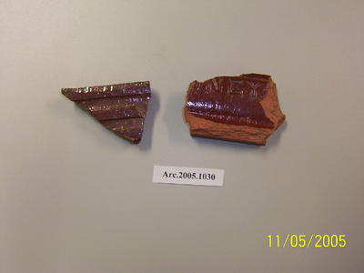 Two (2) terracotta roof tile fragments with partial imprint