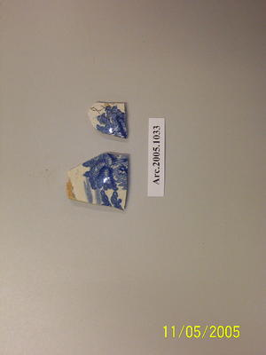 Ceramic fragments with a blue on white willow pattern