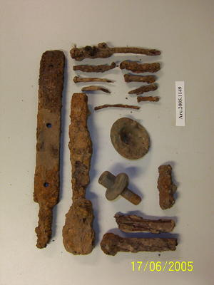 Various metal fragments including nails and bolts