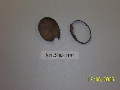 Fragments of a brass locket, including lid and rim, no clasp
