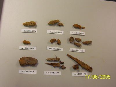 Unidentified metal fragments, in rusted condition
