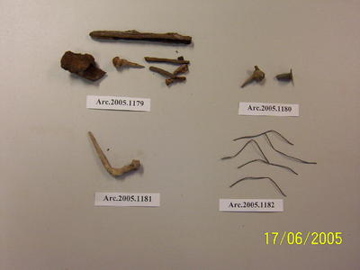 Various metal fragments, including nail and tube fragments