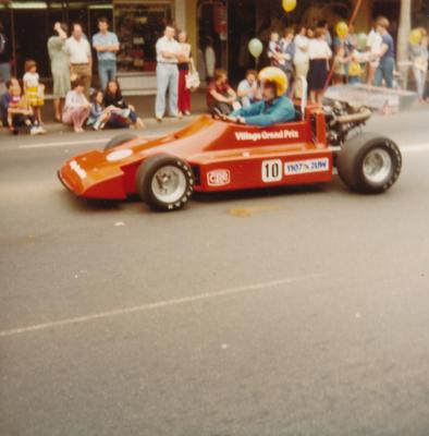 Small Formula One-style car in Parramatta Foundation Day Parade