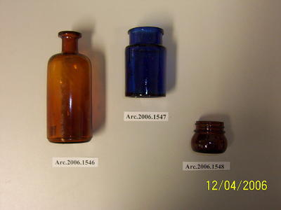 Small brown round glass bottle, possible medicine bottle